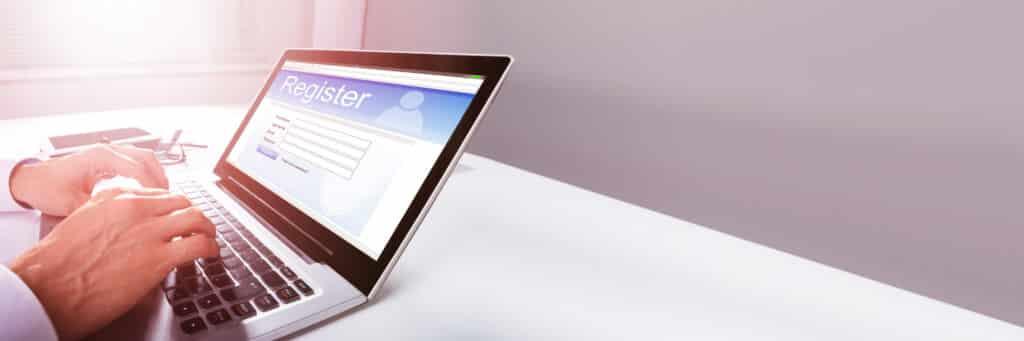 Filling Website Online Registration Form On Laptop Screen
